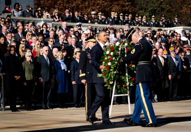 president_of_the_united_states_barack_obama_positions_a_commemorative_wreath_during_a_veterans_day_ceremony_at_the_tomb_of_the_unknowns_in_arlington_national_cemetery_arlington_va-_nov-_11_2013_13